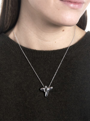 the-handheld-sculpture-bethlehem-cross-becomes-wearable-as-necklace-1